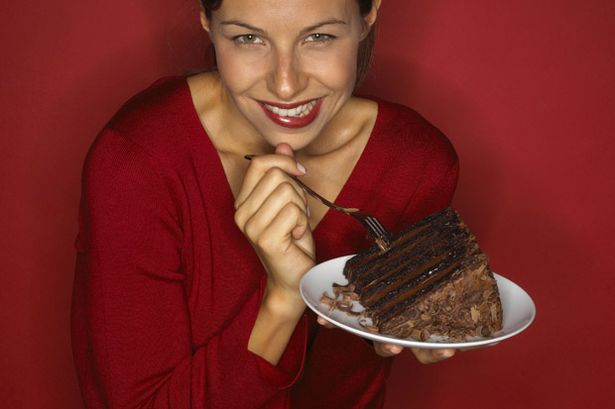 Woman-eating-a-chocolate-cake