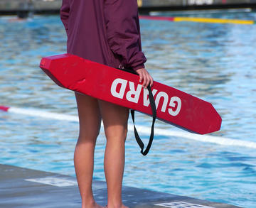 1000-lifeguard-standing-by-pool