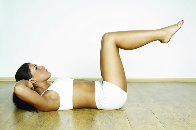 Young beautiful woman during fitness time and exercising